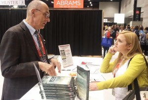 "Author John Guglowski chats with Vicki Pietrus in the ""Books from Poland"" booth."
